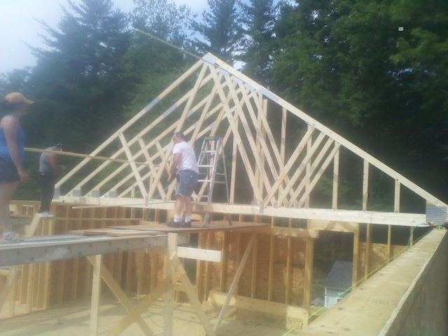 Here you can see we are setting the roof trusses on the garage